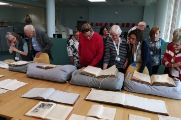 volunteers looking at archives
