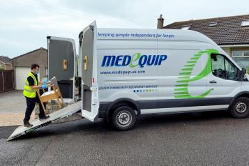 man loading chair onto Medequip van