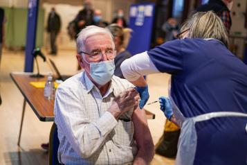 man receiving covid vaccine