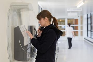 woman at payphone