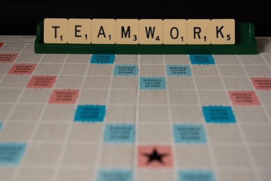 scrabble counters spelling teamwork
