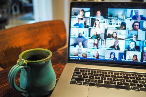 people in a virtual meeting on laptop screen